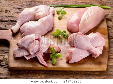 Raw uncooked chicken meat on wooden board. Healthy eating