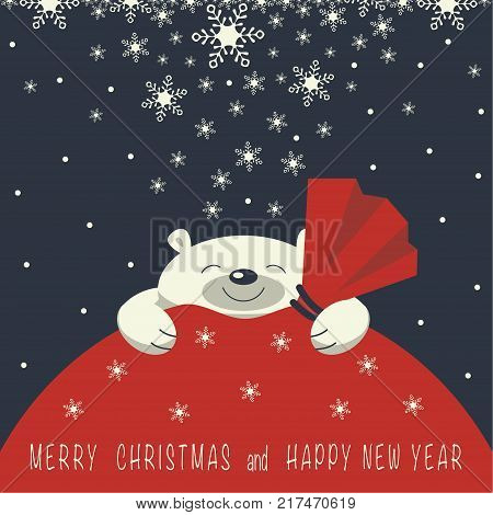 Christmas card. The smiling polar bear is on the red gift bag. Gift bag is red color. On the gift bag the phrase merry Christmas and a happy New year.