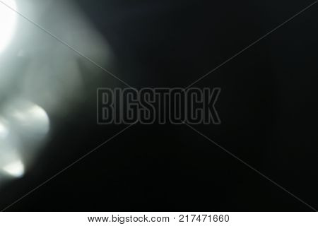 Real Lens flare light effect. Sparkle ray leak on black background. Optical effect of spotlight. Flash leak beam.