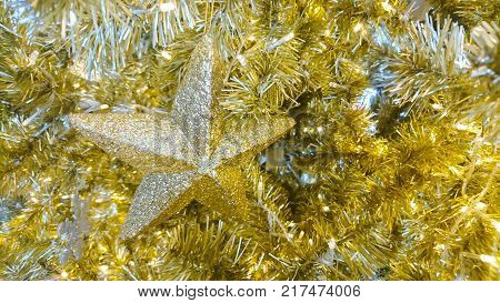 Christmas star object with gold background shinny