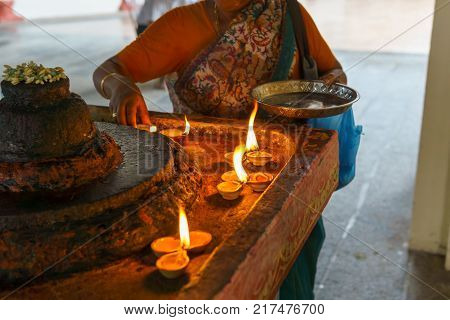Candles to bless God with female hindus in the hindu temple. Religion concept..