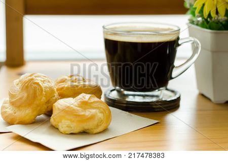 Breakfast, A cup of hot coffee and choux cream