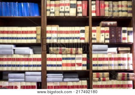 Bookshelf plenty of old legal volumes. Blurred background