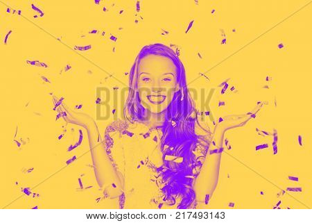 people, holidays and emotions concept - happy young woman or teen girl in fancy sequin dress catching confetti at party, trendy duotone effect