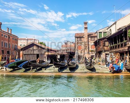 VENICE, ITALY - SEPTEMBER 6, 2013: Squero di San Trovaso - gondolas workshop. Typical Venetian yard where are created and repair the boats like gondolas and other typical boats of the Venetian lagoon
