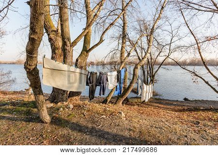 Laundry Drying On A Wire, Under The Mild Winter Sun, Near The River