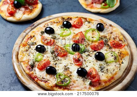 Pizza with Cherry Tomatoes, black Olives and Jalapeno Pepper and mini Pizzas
