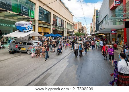 Adelaide Australia - November 14 2015: Crowds of people visiting Rundle Mall precinct to do shopping before Christmas on a day. Rundle Mall is a pedestrian street mall located in Adelaide South Australia