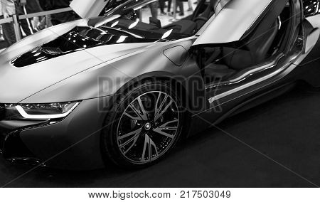 Sankt-Petersburg Russia July 21 2017: Luxury BMW i8 hybrid electric coupe. Plug-in hybrid sport car. Concept electric vehicle. Car exterior details. Black and white. Photo Taken at Royal Auto Show July 21
