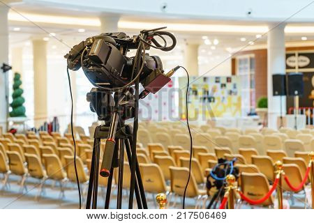 Professional digital video camera under the tripod. accessories for 4k video cameras. tv camera in a concert hall.