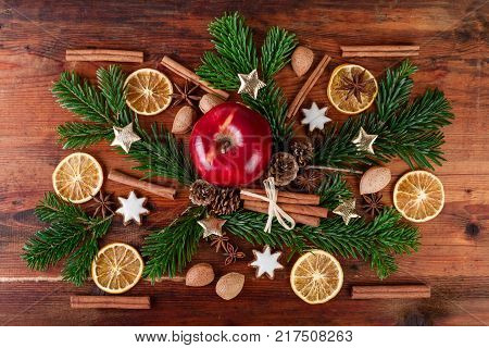 traditional christmas spices with red apple countrified decoration over wooden background Top view