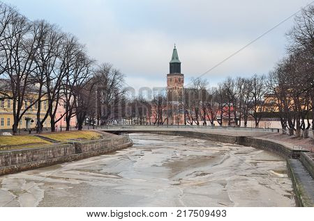 Turku Finland. The embankment of the frozen river Aura in a winter day