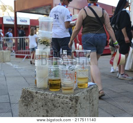 LE MANS, FRANCE - JUNE 16, 2017: Garbage from plastic cups and bottles with beer on the street after the parade of pilots racing in Le mans, France