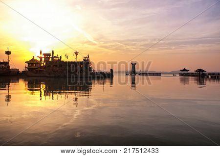 The three kingdoms scenic area Wu replica naval base in the Wuxi China on Tai lake or taihu in Jiangsu province at sunset.