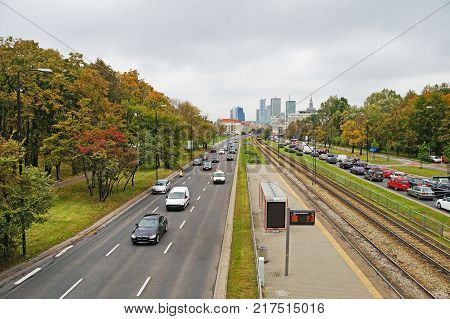Speedy road passes through Warsaw. View of Warsaw, view of the park and the skyscrapers of Warsaw.