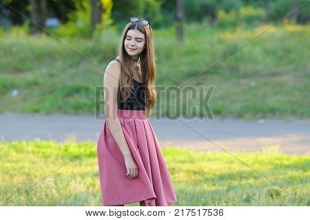 Woman with long hair and beautiful eyes on a green background shows the different human emotions. Lady portrays dream, smile, shy,
