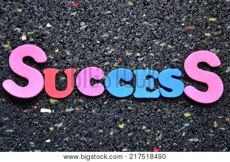 word success on an abstract colored background