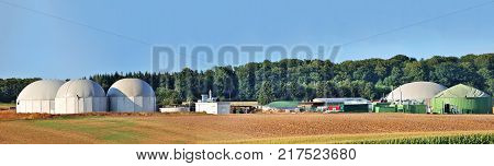 Bio fuel plant panorama with forest in background.