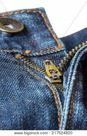 Close-up of open, unzipped and unbuttoned blue denim jeans isolated on white background.