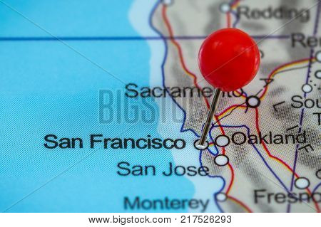 Close-up of a red pushpin on a map of San Francisco, USA