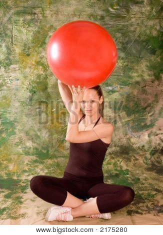 A young girl exercise with ball rollout poster