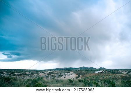 Beautiful view of the hills of Cappadocia in Turkey against the backdrop of a dramatic evening sky. They are one of the main natural attractions of these places