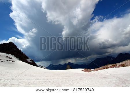 Thunderstorms approach Sperry Glacier in the mountains of Glacier National Park USA