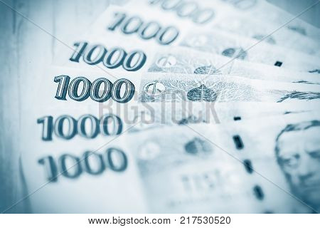 Banknotes of the Czech currency. business finance saving and cash concept - close up of czech paper money and coins on table. blue colored