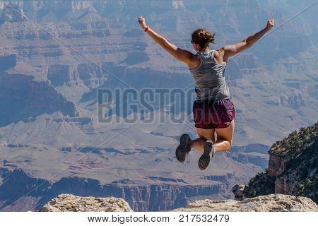 Leaping Over the Rim of the Grand Canyon on a hot summer day
