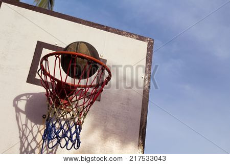 Basketball game outdoor equipment. Basket and ball. Accurate ball throw in basket. Street basketball. School holiday activity. Basketball competition. Basketball game in open field. Active lifestyle