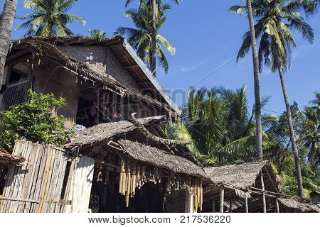 Dumaguete Philippines - 1 Nov 2017: Souvenir shop with native decoration. Rustic tribal house with dry leaf roof. Tourist gift shop entrance exterior. Simple house under palm trees. Tropical vacation