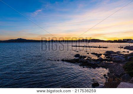 Colorful sky over La Maddalena at sunset. Sardinia Italy