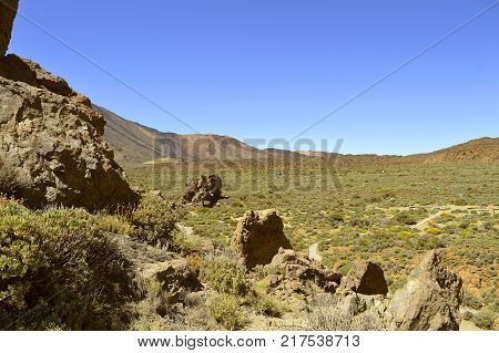 A tour coach driving through Mount Teide National Park in Tenerife