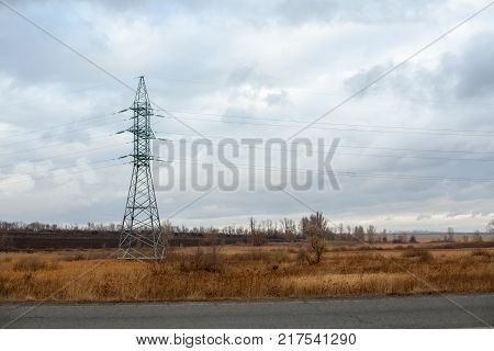 Heat Haze Rises As Powerlines Blur Into The Distance