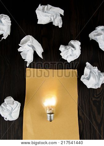 great idea concept with crumpled paper and light bulb on wooden table, Inspiration concept , Great idea