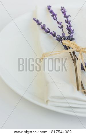 White Plate Linen Napkin Tied with Twine Lavender Twig Easter Wedding Valentine Romantic Table Setting Menu Poster Template Copy Space