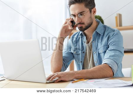 Attractive Skilled Bearded Male Manager Of Business Company Speaks With Partner Via Mobile Phone, Me