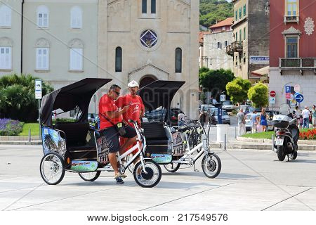 SPLIT, CROATIA - SEPTEMBER 11, 2016: Unidentified trishaws wait for the wish to perform a bike tour around the city.