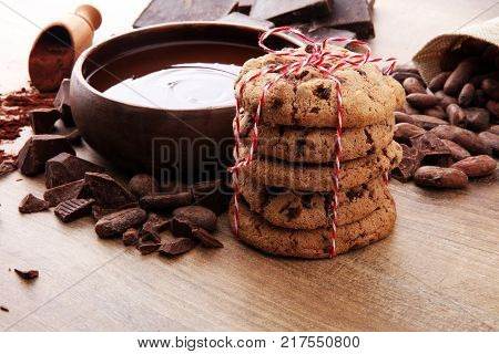 Chocolate cookies on wooden table. Chocolate chip cookies.