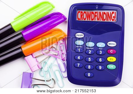 Writing word Crowdfunding text in the office with surroundings such as marker, pen writing on calculator. Business concept for Business Fundraising Project Funding white background with space