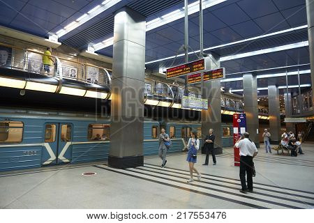 MOSCOW, AUG, 22, 2017: Two levels floors metro station Business Center, blue train and train waiting people. Passengers on railway station platform. New modern metro station architecture. Metro museum