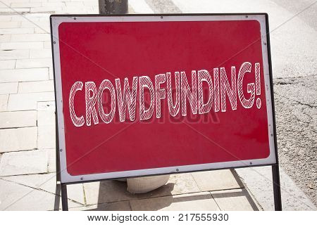 Conceptual hand writing text caption inspiration showing Crowdfunding. Business concept for Business Fundraising Project Funding written on announcement road sign with background and space