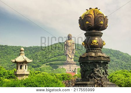 The Lingshan grand Buddha scenic attraction in Wuxi China in Jiangsu province with the nine dragon bathing fountain in the foreground.