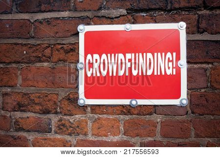 Hand writing text caption inspiration showing Crowdfunding concept meaning Business Fundraising Project Funding written on old announcement road sign with background and space