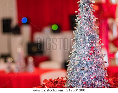 Holiday Party with red and white themed decor with bar in the background, selective focus, shallow DOF
