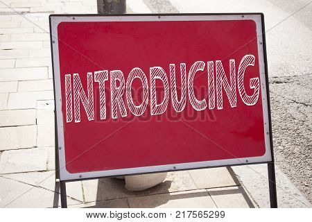 Conceptual hand writing text caption inspiration showing Introducing. Business concept for Introduction Start Intro Beginning written on announcement road sign with background and space