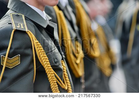 Closeup of military officers on parade wearing uniform with epaulettes