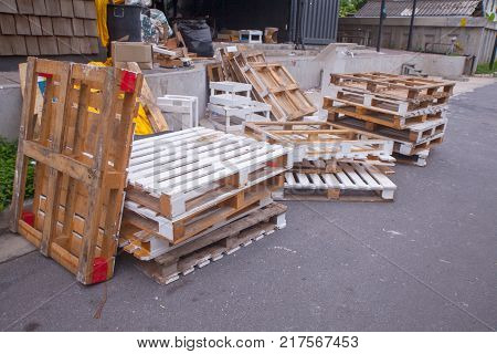 Stacks of old wood pallets at the park