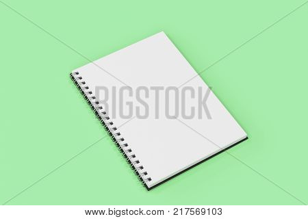 Opend Notebook Spiral Bound On Green Background