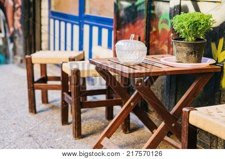 Turkish street cafe in Istanbul. Wooden table and chairs stand directly on the street. A distinctive and authentic place to visit by locals. Morning time.